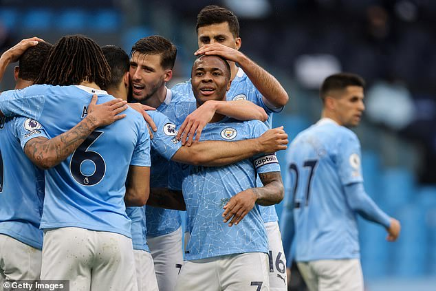 City took the lead when Raheem Sterling (right) swept home just minutes before half-time