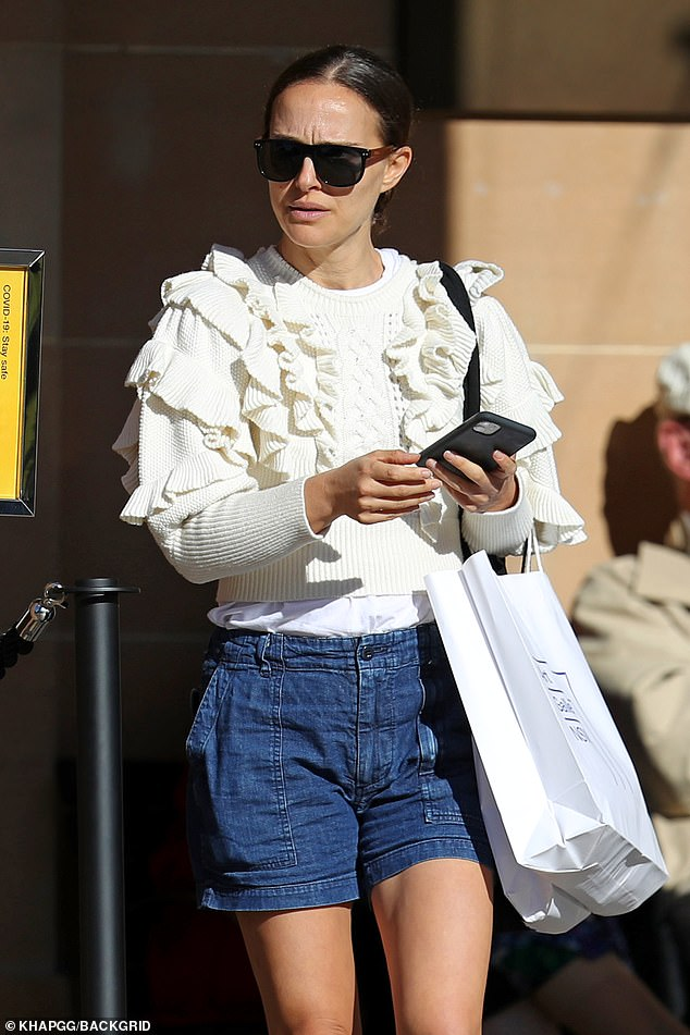 Souvenir shopping:While leaving the venue, Natalie was seen carrying a large white, following a stop at the gallery's gift shop