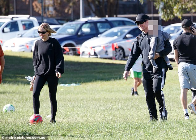 Outside: Lara Worthington (Née Bingle) and her husband Sam Worthington were enjoying a soccer game with their sons on Saturday.  Lara and Sam are pictured