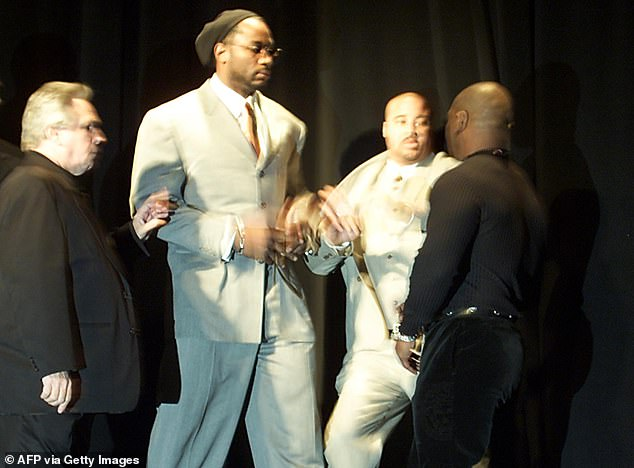 The skirmish started after Tyson stormed over to Lewis and swung at one of his bodyguards