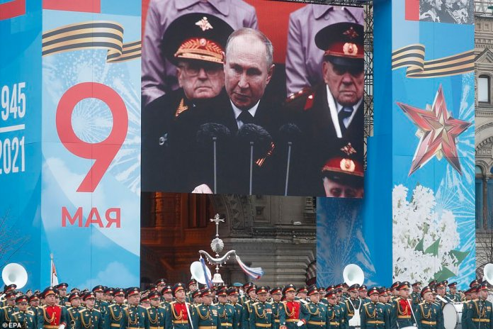 Screen shows Russian President Vladimir Putin speaking during the Victory Day military parade in Red Square in Moscow