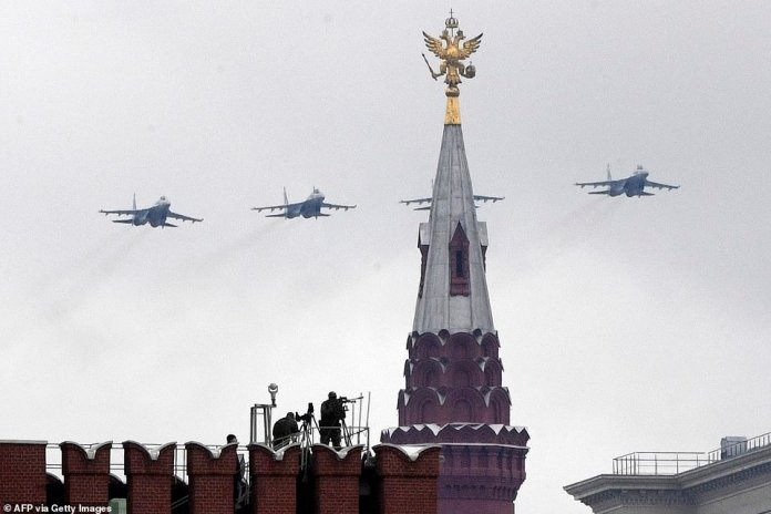 Russian Sukhoi Su-35S fighters fly over central Moscow during Victory Day military parade on May 9