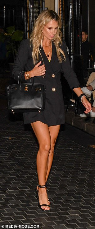 Adding height: The cricket WAG elongated her frame with a pair of black stiletto heels
