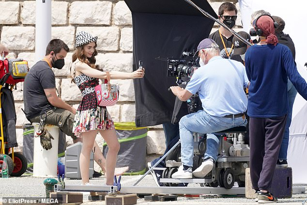 Say Cheese: Visibly pleased with the character's latest set, Lily took a series of cheerful selfies while relaxing on the outdoor set