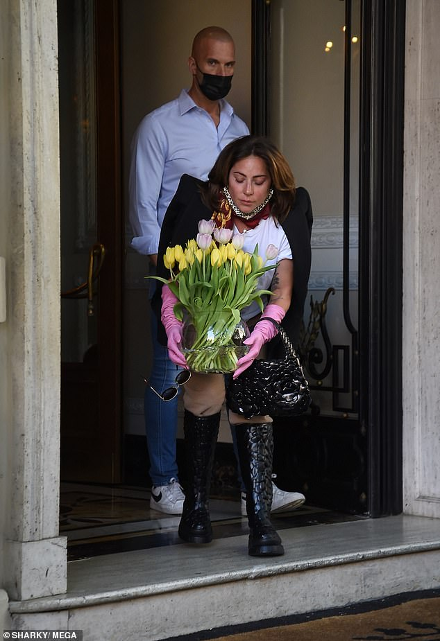 Thoughtful: The singer carried the tall vase outside and threw the pretty flowers at the fans