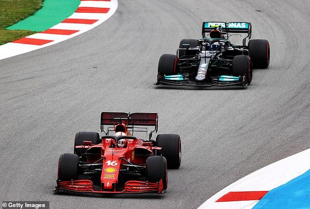 Charles Leclerc (below) passed Mercedes' Valtteri Bottas (top) on the first turn