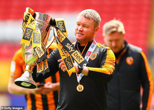 Hull City manager Grant McCann celebrates with the League One trophy after being crowned champions and securing promotion to the Championship