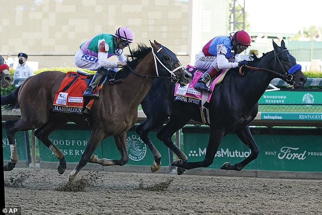 Racing officials said Mandaloun (left) would be promoted to winner if the findings are upheld