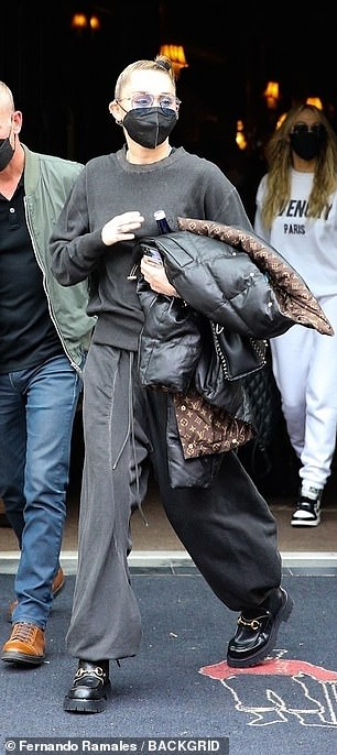 Style: The Plastic Hearts singer, 28, donned baggy harem pants and a long-sleeved sweatshirt for the travel excursion, along with chunky black boots with golden buckles