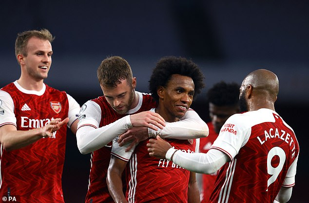 Team-mates mobbed the delighted Brazilian after he curled in a free-kick against West Brom
