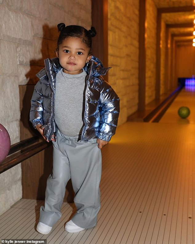 Adorable: The doting mom, who shares her mini-me with on-again, off-again boyfriend Travis Scott, also included a solo shot of Stormi at an in-home bowling alley