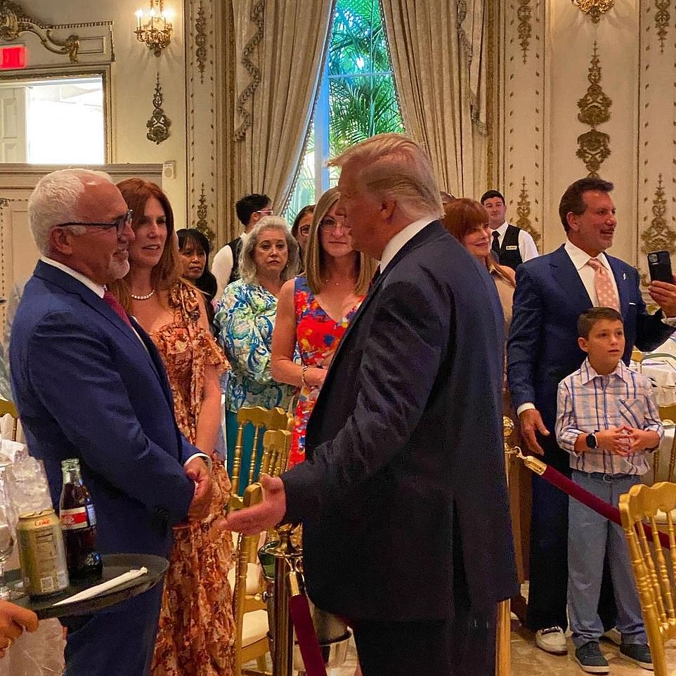 Trump is pictured speaking with guests at the Mother's Day brunch atMar-A-Lago on Sunday