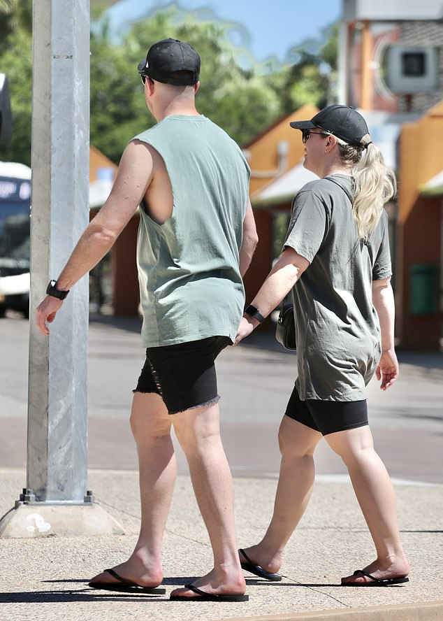 In tandem: They even sported matching black sports watches and and flip-flops
