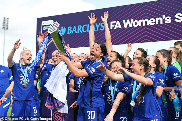 Sam Kerr celebrates with the Barclays FA Women's Super League Trophy following Chelsea's victory againstReading on Sunday