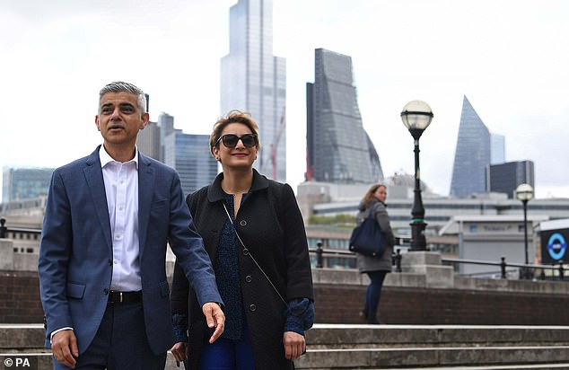 Mayor of London Sadiq Khan, with his wife Saadiya, arrive for his signing in ceremony at Shakespeare's Globe Theatre on London's Southbank