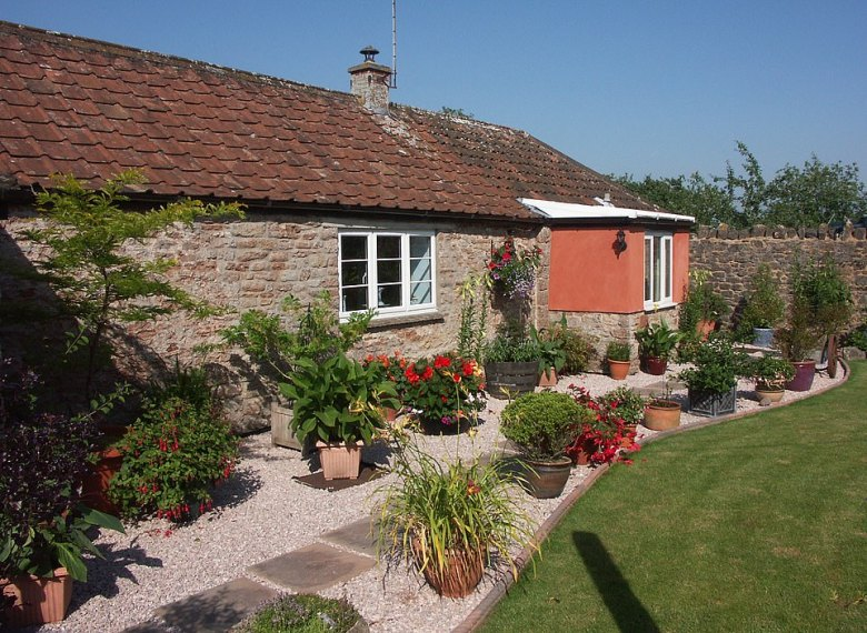 Cider Barrel Cottage in Somerset is a former cider store that is now an inviting two-bedroom house