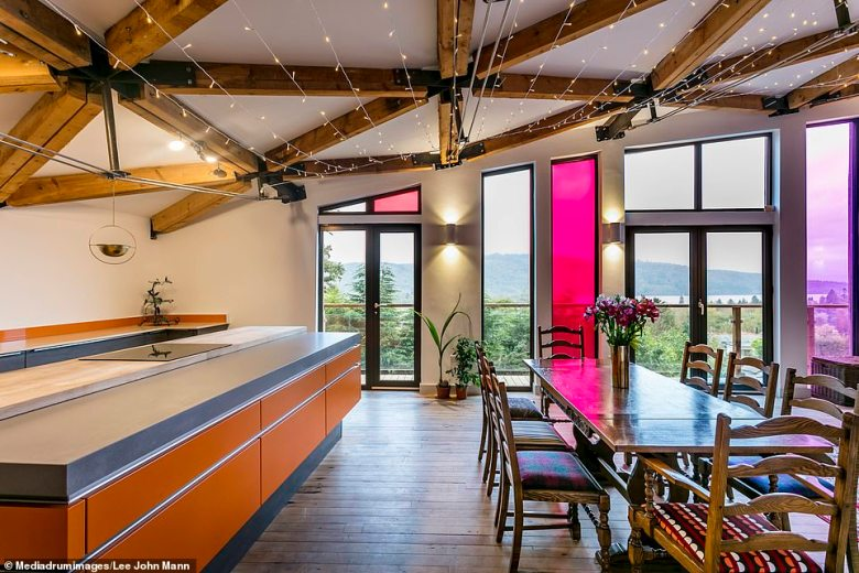 A private kitchen area comes complete with a dining table with large windows showcasing the beautiful scenery