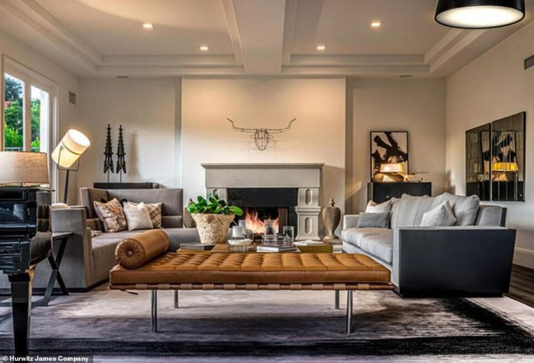 The living room features an oversized fireplace...