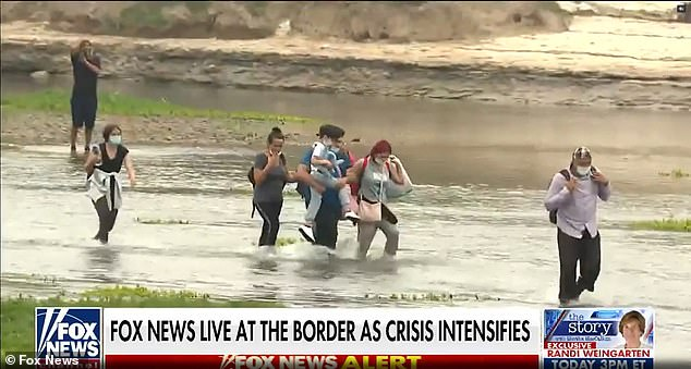 Footage taken Monday shows migrants continuing to come into the United States at the Rio Grande in Texas amid an ongoing crisis at the southern border with Mexico