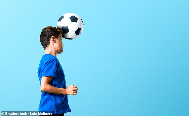 One third of children who suffer concussion develop anxiety, depression and other mental health issues, a study has claimed. There has been a growing focus on the possible health impacts of children heading footballs regularly (stock image)
