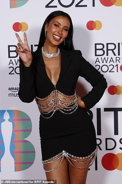 Gorgeous: Elsewhere presenter Maya, 26, looked sensational as she displayed her toned curves in a plunging cut-out black mini dress