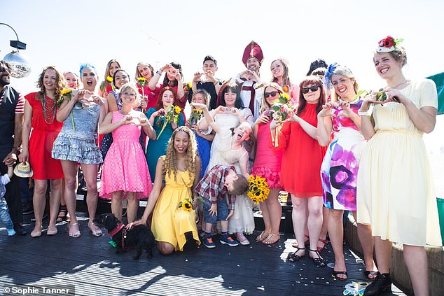 Sophie, who doesn't wear a wedding ring, said she wore a costume ring for her wedding ceremony as a symbolic gesture. Pictured: Sophie and guests at her wedding