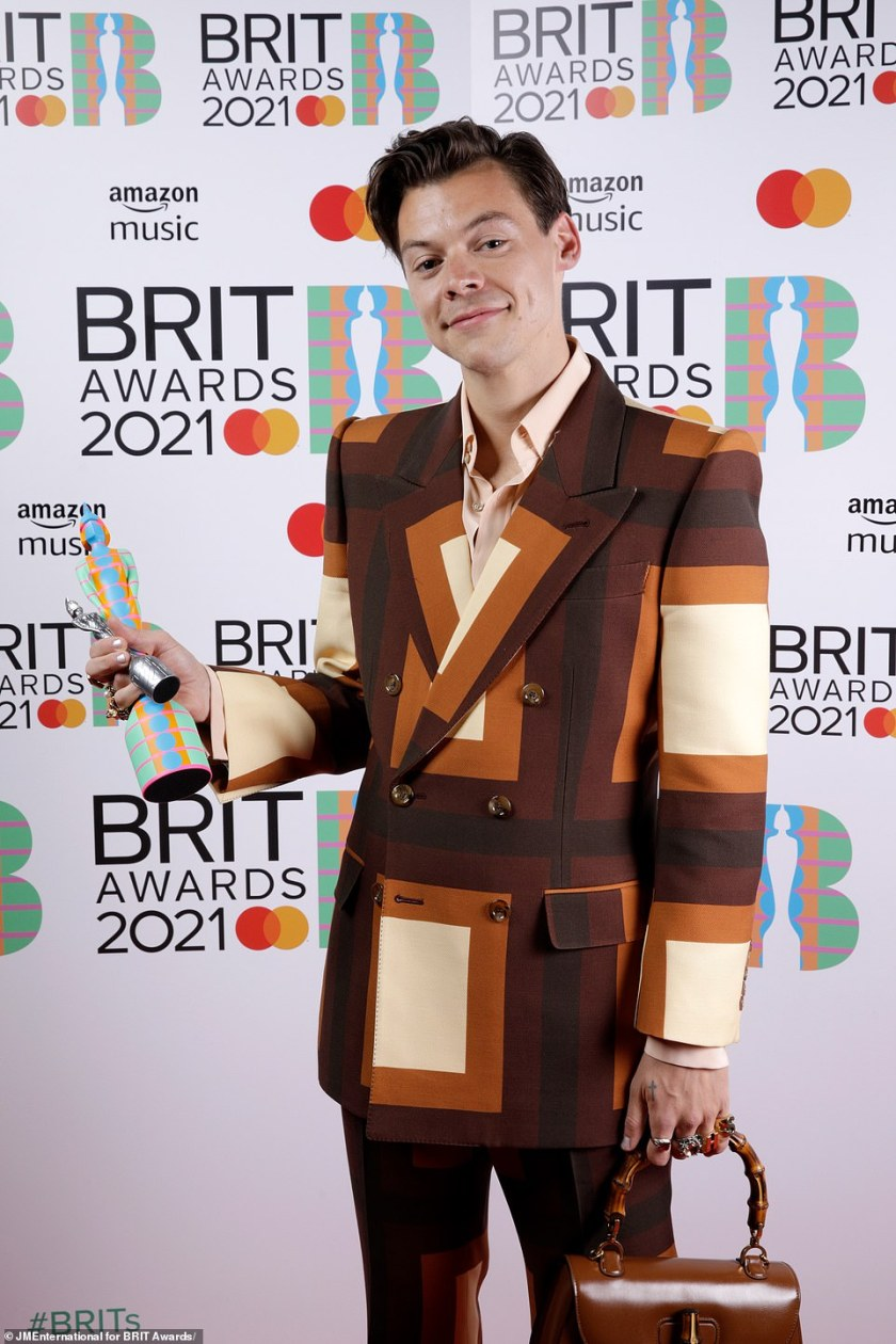 Nice one: A very dapper looking Harry Styles took home the trophy for British Single with his tune Watermelon Sugar