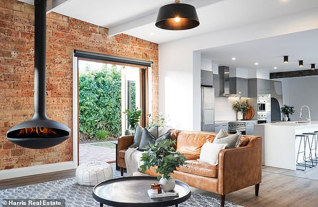 Stunning:The property, which soldfor an undisclosed price, features sliding doors leading to the open-plan lounge, which is complemented by exposed brick walls and a hanging fireplace