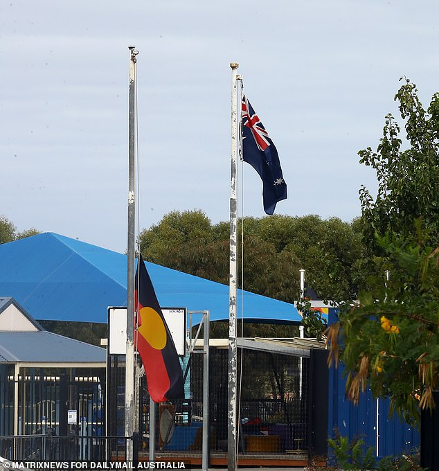 Spencer's school flew the Aboriginal flag at half mast on Wednesday in tribute to him