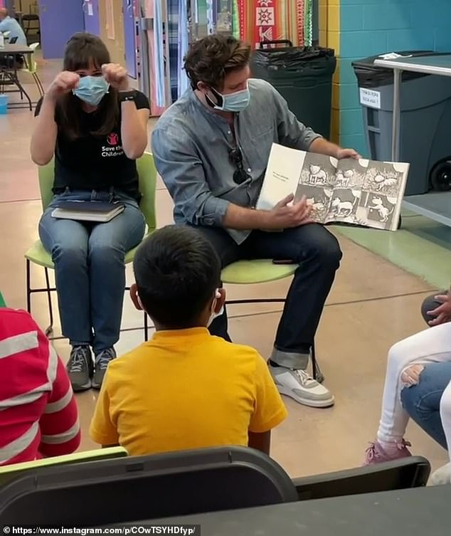 Teamwork:The two also worked together to lead a story time session for the young children as they read books for them, which the 13 Going On 30 star acting them out