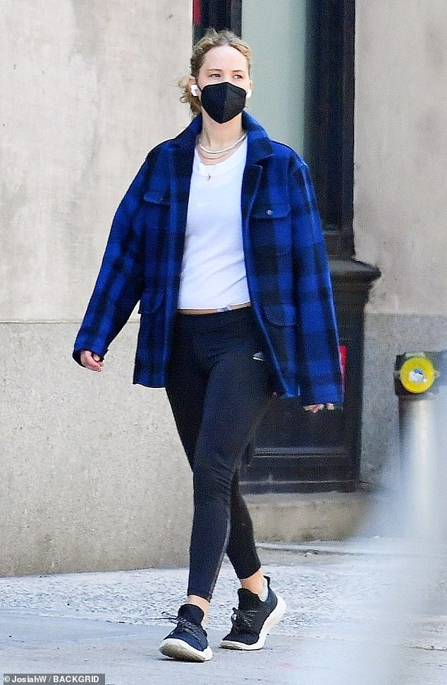 Errands day:The actress rocked Adidas black leggings with a white shirt, revealing a hint of her flat midriff