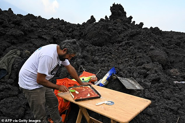 Garcia (pictured) started baking pizzas in small caves on the mountainside in 2013. `` I put it in a warm cave around 800 degrees. [1400 degrees Fahrenheit] and it came out in 14 minutes'