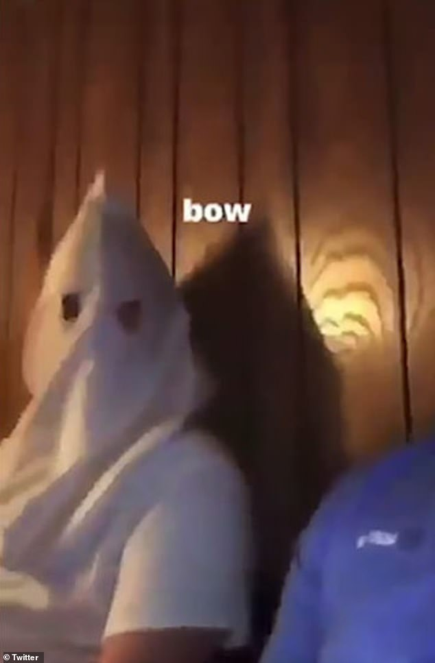 Kennedy was seen in a social media clip seated next to a person wearing an apparent Ku Klux Klan hood