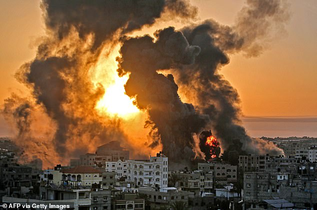 A fire rages at sunrise on Wednesday following an Israeli airstrike on the southern Gaza strip