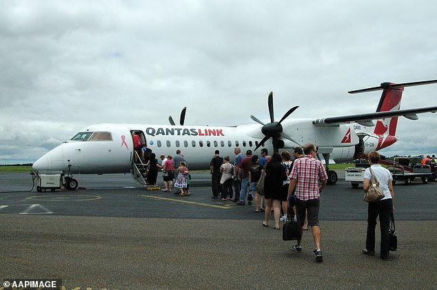 A Qantas Dash-8 flight has been forced to make an emergency landing at Brisbane Airport on Thursday (pictured stock image of a Dash-8 plane)