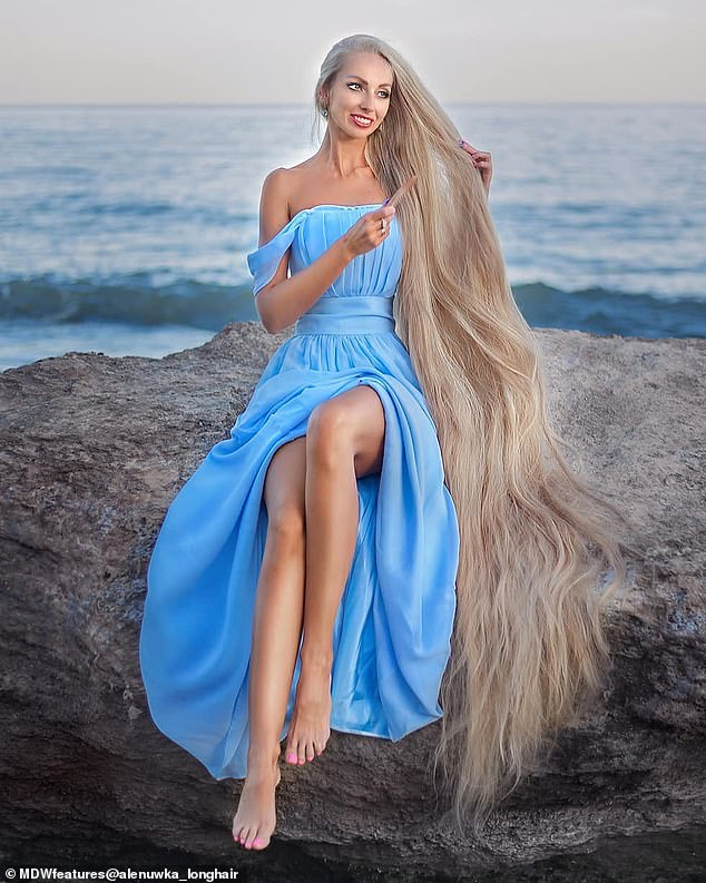 Real-life RapunzelAlena Kravchenko, from Odessa, Ukraine, with 6.5ft-long natural, blonde hair who hasn't cut her locks in 30 years has revealed the secret behind growing her golden tresses