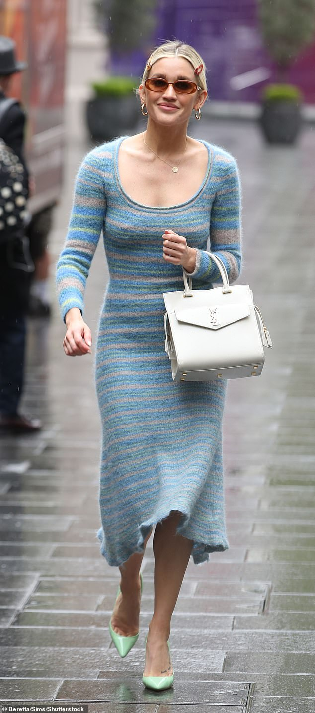 Stylish: Bracing the capital's chill bare-legged, the Pussycat Doll teamed her stripy blue frock with mint-hued heels and toted a luxury white YSL handbag on her left arm