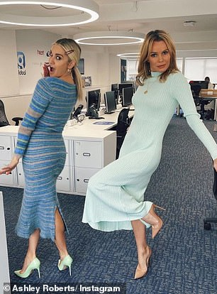 Fun: Ashley also posted a snap of her look on Instagram, posing up a storm alongside co-host Amanda Holden in the radio station's office