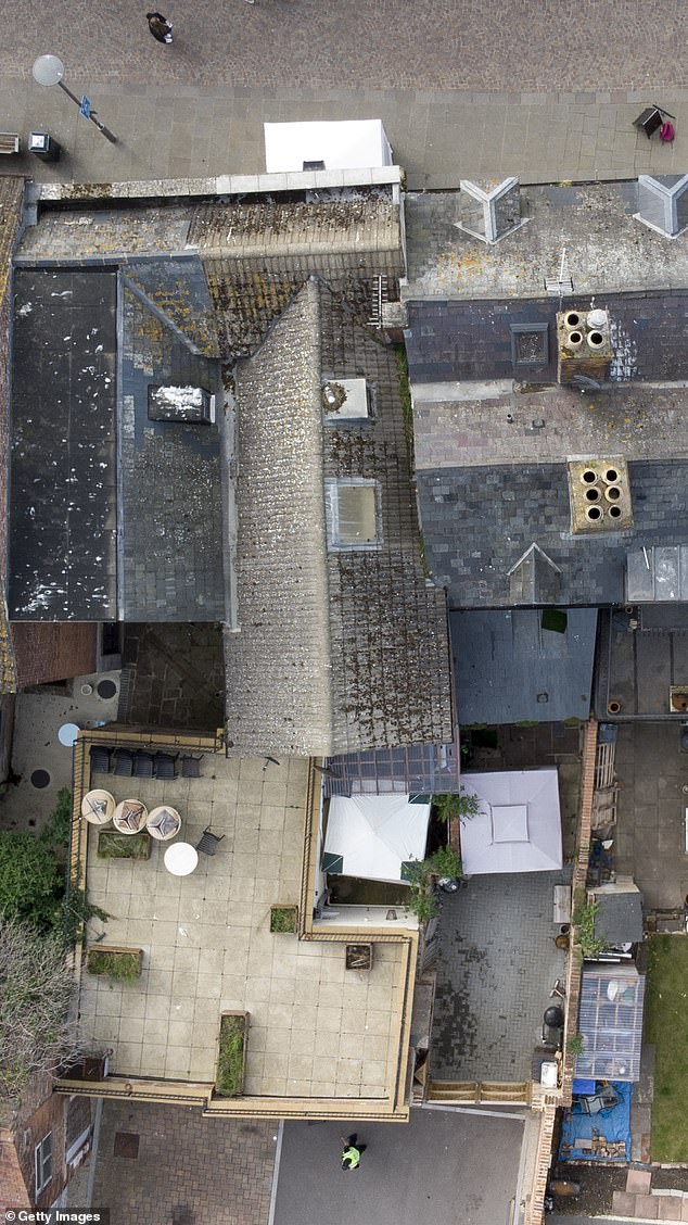 Drone picturesdirectly above the Clean Plate Cafe on Southgate Street show that police have put up forensic tents at the front and rear of the property, where West may have helped lay the floor and built a toilet