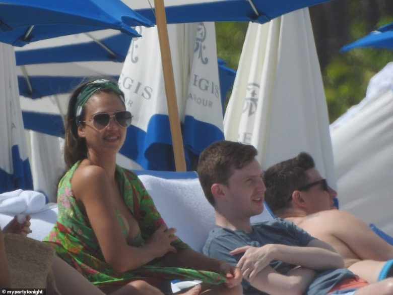 After an afternoon of swimming and water football, Alba was seen relaxing and basking in the sun at the hotel's VIP cabanas