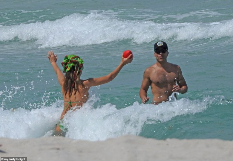 Warren, who has been married to Alba since 2008, also appeared to be in great shape. He wore a baseball cap and sunglasses and he played football with his wife in the water