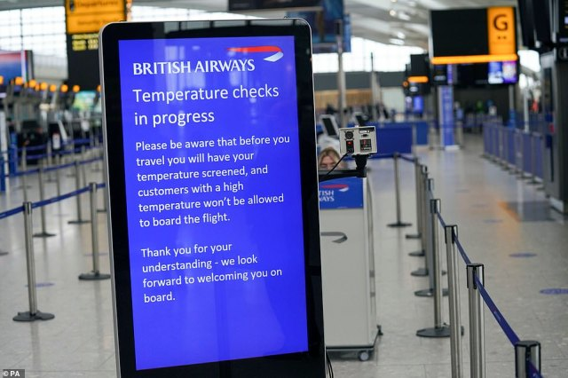 Temperature checks on passengers in the departures area in Terminal 5 at Heathrow Airport in west London today