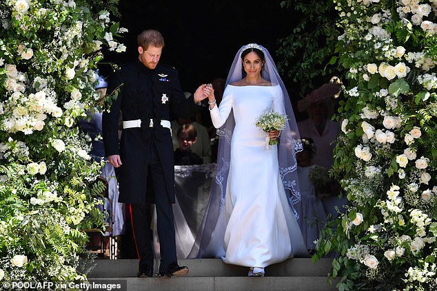 Wedding day: Prince Harry and Meghan Markle are pictured walking down the west steps of St George's Chapel, Windsor Castle, in Windsor, on May 19, 2018