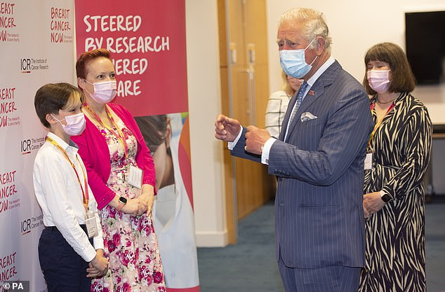 Duties: Prince Charles was pictured on Thursday meeting Oscar Coulson-Starley, 11, and mother Danni Starley, 45, from Kent, England, during a visit to the the Breast Cancer Now Toby Robins Research Centre in London, 21 years after he formally opened the research centre