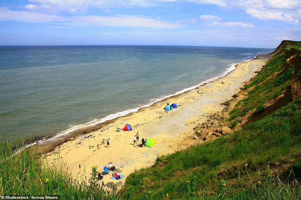 East Runton Beach in Norfolk, pictured, has retained its Blue Flag status for 2021