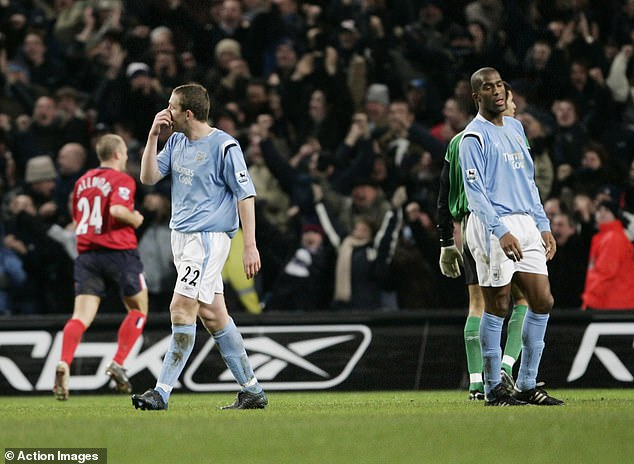 Richard Dunne (left) messed up with David James in Man City's draw with West Brom