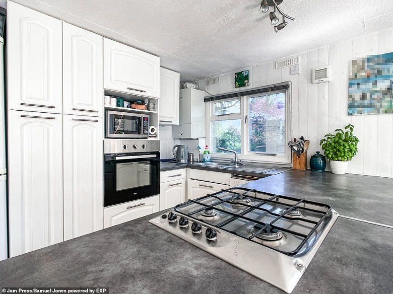 The home boasts a modern interior with a U-shaped kitchen and breakfast bar.The tiny island is a short distance from Hampton Court train station, close to Hampton Court Palace and Royal Bushy Park