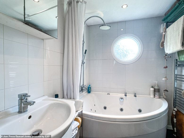 Thefamily bathroom with a jacuzzi bathtub.Tom Parker, consumer spokesperson at Zoopla, said: 'This beautiful houseboat has a lot to offer prospective buyers including a modern, spacious interior and roof terrace'