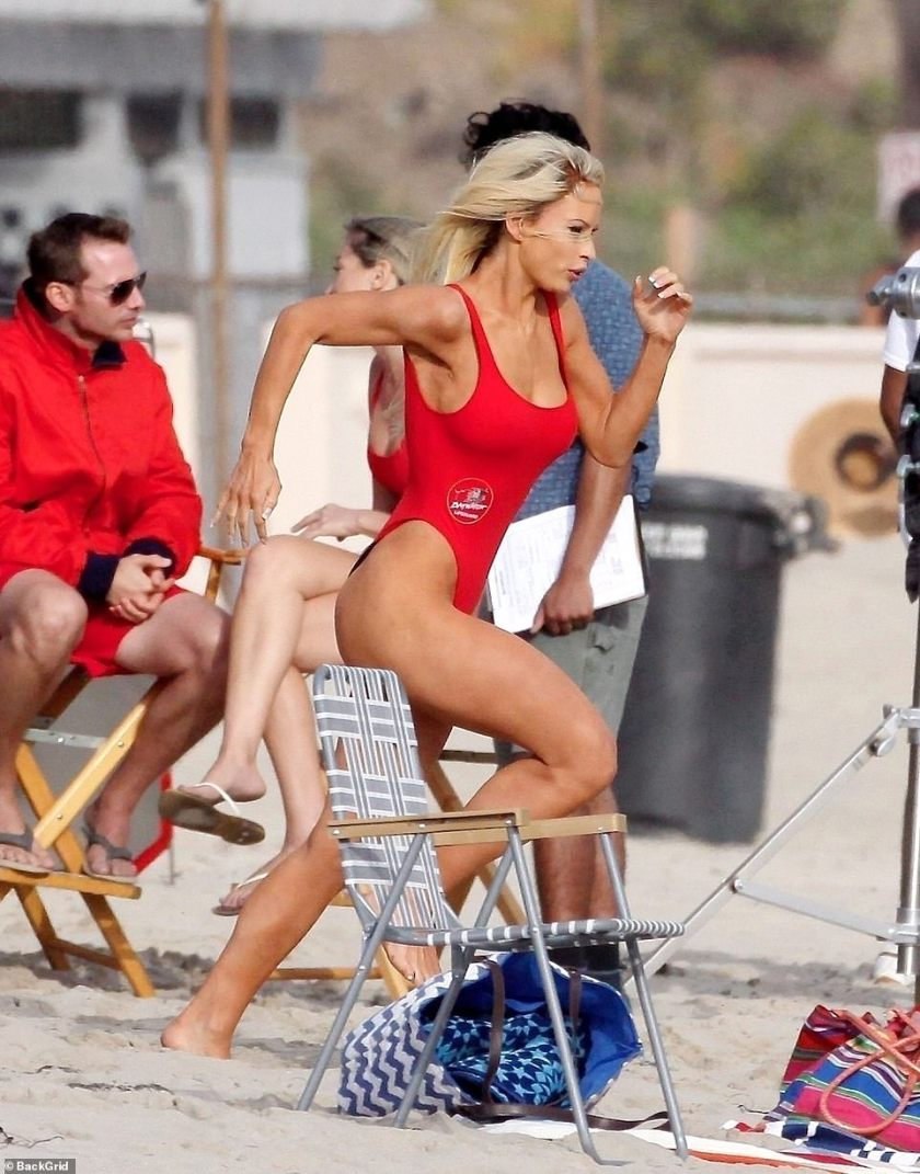 She'll be there: Emulating the iconic series about a group of lifeguards wouldn't be complete without filming a scene running down to the ocean in slow-motion as Lily could be seen doing it several times just to get it right