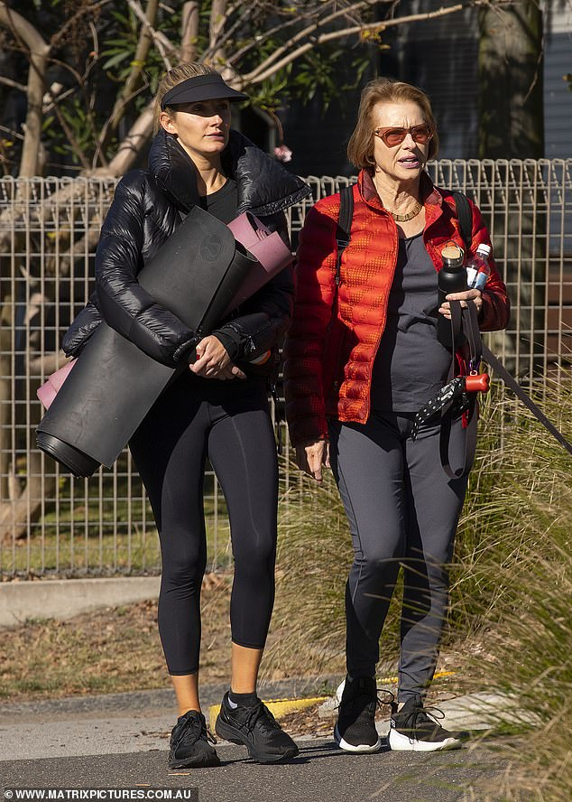 Ready to go! Horse trainer Gai, 66, opted for a brighter look in an eye-catching red puffer jacket and black leggings